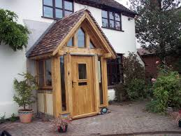 Pitched Porch Roof Design Oak Porch With Glass Surrounds With Red Tile Pitched Roof