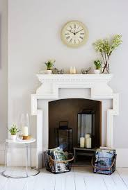 non working fireplace with lanterns and accessories