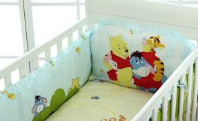 image of winnie the pooh nursery bedding cushions and blanket