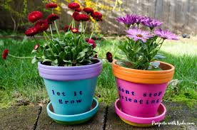these bright and cheerful diy painted flower pots are so fun and easy for kids to