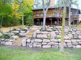 terraced retaining wall to ilize steep hills and wash out areas the materials we use are harvested boulders keystone block and landscape timbers