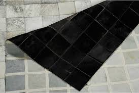 white gray and black patchwork cowhide rug in squares showing the backing