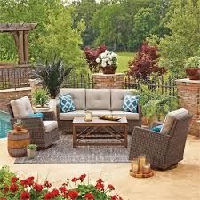 in outdoor wicker patio furniture set with sunbrella dove cushions