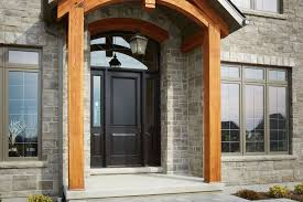 beautiful photo of steel doors on stone home