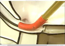 richard trethewey demonstrates the best way to unclog a clogged toilet