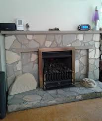 old fireplace and gas fire