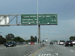 this mileage sign along southbound interstate 405 eastbound california 22 provides the distance to the next two exits exit 21 california 22 garden grove
