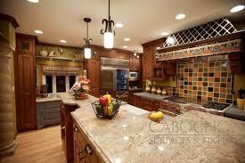 custom inlay spanish ceramic tile on kitchen backsplash and hood