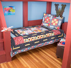 7 Baby Quilt Kits That Will Delight Any Baby Boy or Girl ... & Robert Kaufman mode of transportation quilt kit Adamdwight.com