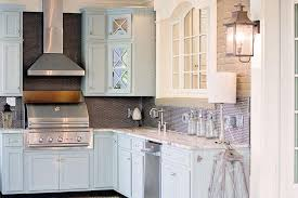blue kitchen cabinets with fantasy brown granite countertops view full size