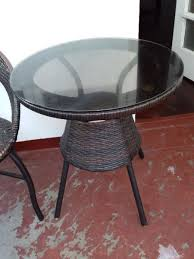 patio weatherproof round glass topped coffee table with 2 wicker chairs