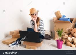 young female just moved in a new house mortgage and loan concept