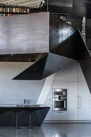 kitchen white cabinet undermount sink wall oven and concrete floor the kitchen on dwell metal wall art with photo 13 of 19 in two art world veterans live in this mind bending