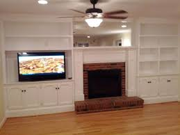 custom fireplace built in shelves remodel traditional living room