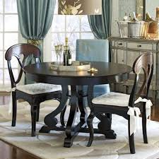 marca round dining table rubbed black