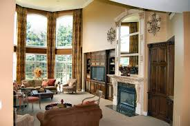 philadelphia decorative corbels family room traditional with marble slab fireplace hearth side tables and end blush pink accents