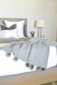 how to make up a beautiful bed pom pom throw gray nailhead upholstered bed white and