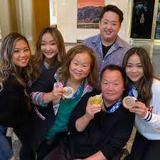 Watch: Suni Lee reunites with family on ...