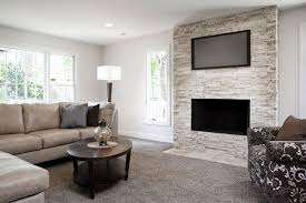 modern living room with fireplace and tv. Getty ImagesJohn Fedele Modern Living Room With Fireplace And Tv