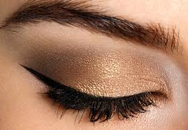 step 5 define the upper lashline with a bold liner and generously coat lashes with