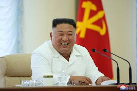 Grinning Kim Jong-un sits yards away from party officials after emerging  from hiding amid coronavirus pandemic