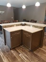 maple cabinets in a driftwood sn with everest quartz countertops a rust chocolate tile backsplash