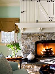 inspiration for a timeless bedroom remodel in new york with green walls a stone fireplace