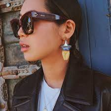 at times like this when i m really barefaced i love wearing statement earrings like these chloé figure earrings which i mismatched on purpose i think