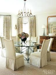 a weeks chandelier hangs above the round dining room table linen velvet covered niermann italian knock