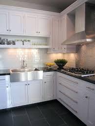 black kitchen floor black granite worktop grey and black tiles white gloss units black kitchen floor