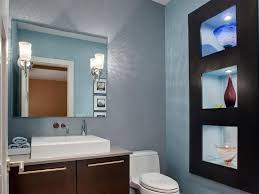 light grey wall color with frameless mirror and deep brown wooden vanity cabinet for enticing mid century modern bathroom