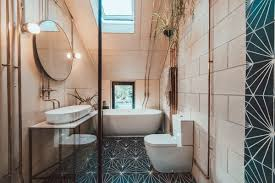 a k inside the adjoining master bathroom decorated with marrakesh design wall tiles air plants