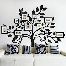 living room family photo wall collage design combined with black tree wall decals on white wall