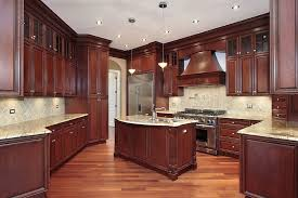 Best wood for kitchen cabinets Cabinet Doors Here We Have Another Great Example Of Cherry Wood Contrasting With More Natural Tone On Home Stratosphere 43 Kitchens With Extensive Dark Wood Throughout