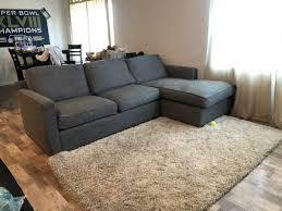 crate and barrel davis sofa with chaise and area rug