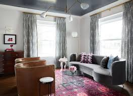 bold pink rug in a gray living room