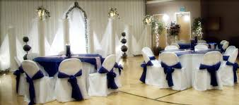 royal blue satin table overlays and chair sashes on white
