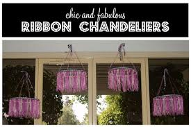 these chandeliers are pretty simple to make but make a big statement all you need is a lot of ribbon a hot glue a wood quilter s hoop