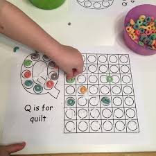 Craft #3: Q is for Quilt from Free Coloring Pages for Kids. My three loved  using glue all by himself and placing fruit loops to make our quilt.