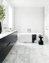 Tour A Black White Bathroom Adorned With Marble House Home