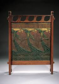 an english vellum and papier mâché decorated oak fire screen circa 1900