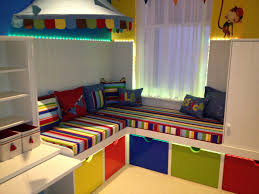 Decorations:Great Concept Kids Playroom With Different Colors Stained  Wooden Drawers And Striped Pattern Upholstered