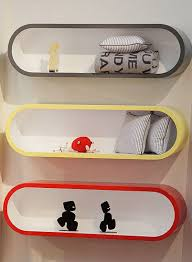 Cute storage on the Lilly and Lolly curved wall shelf