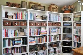 Several bookcases connected together provide a LOT of storage space for  books, magazines, boxes