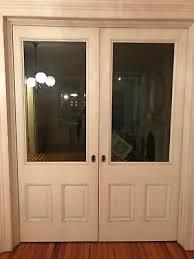 antique victorian wood sliding pocket doors w glass panels