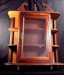 vintage wall hanging curio cabinet shelf table top glass door wood display case