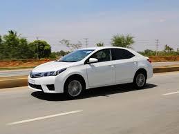 toyota corolla 2015 white. toyota corolla altis 2015 driving white sedan