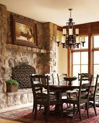 types of kitchen lighting fixtures using wrought iron chandeliers above pedestal fruit bowl also rattan planter