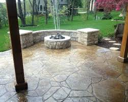 concrete patio designs with fire pit. Unforgettable Traditional Stamped Concrete Patio Ideas With Round Rock Fire Pit Also Wooden Pillars Designs