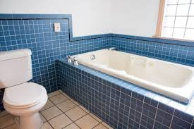 almond tub and almond toilet with cobalt blue tile in bathroom